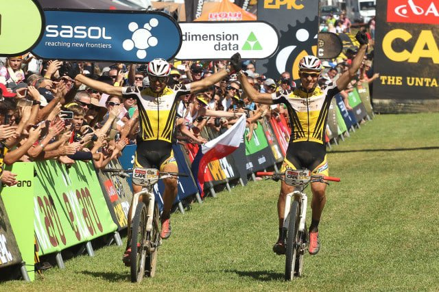 Christoph Sauser of Investec-Songo-Specialized and Jaroslav Kulhavy of Investec-Songo-Specialized celebrate as they win the 2015 Absa Cape Epic during the final stage (stage 7) of the 2015 Absa Cape Epic. Photo by Shaun Roy/Cape Epic/SPORTZPICS PLEASE ENSURE THE APPROPRIATE CREDIT IS GIVEN TO THE PHOTOGRAPHER AND SPORTZPICS ALONG WITH THE ABSA CAPE EPIC