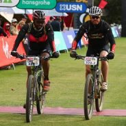 Matt Cook and Sefiso Mkhabela #ConquerAsOne to make it to the Stage 4 finish line - image by Backpage Pix.
