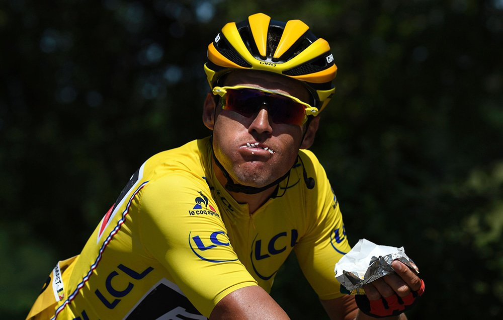 Belgium's Greg Van Avermaet, wearing the overall leader's yellow jersey, eats during the 190,5 km sixth stage of the 103rd edition of the Tour de France cycling race on July 7, 2016 between Arpajon-sur-Cere and Montauban. / AFP / LIONEL BONAVENTURE (Photo credit should read LIONEL BONAVENTURE/AFP/Getty Images)