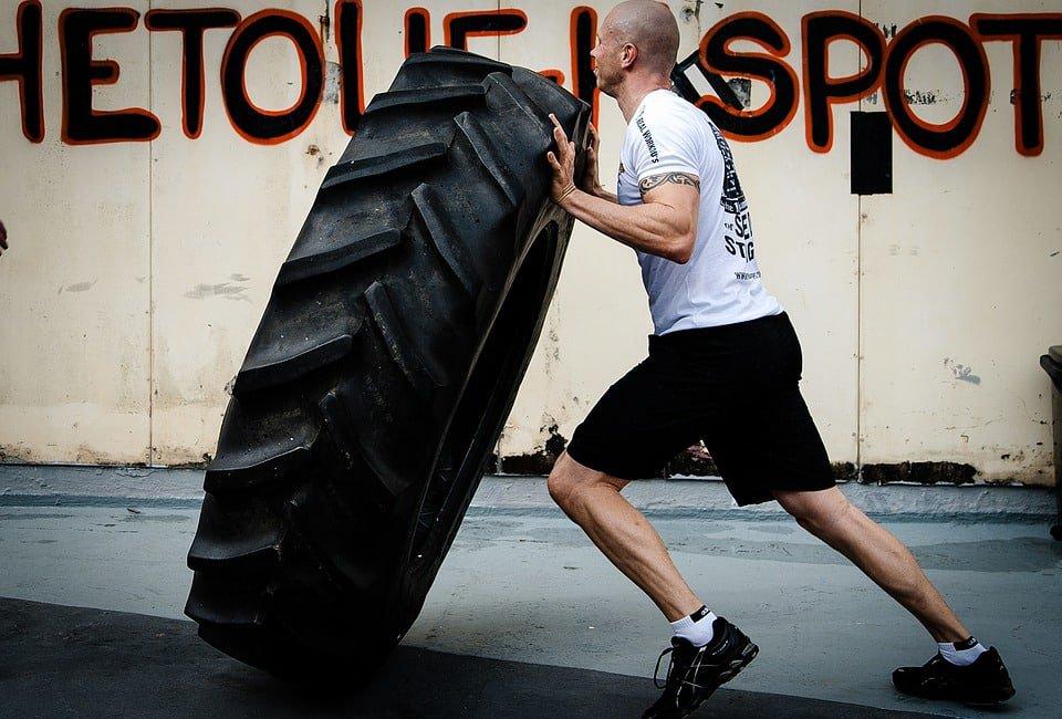 man flipping a tyre